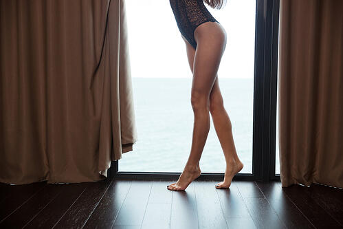 Cropped image of a sexy female legs-1