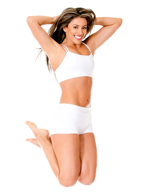 Happy woman jumping in her underwear - isolated over a white background-1