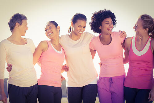 Laughing women wearing pink for breast cancer in parkland-1