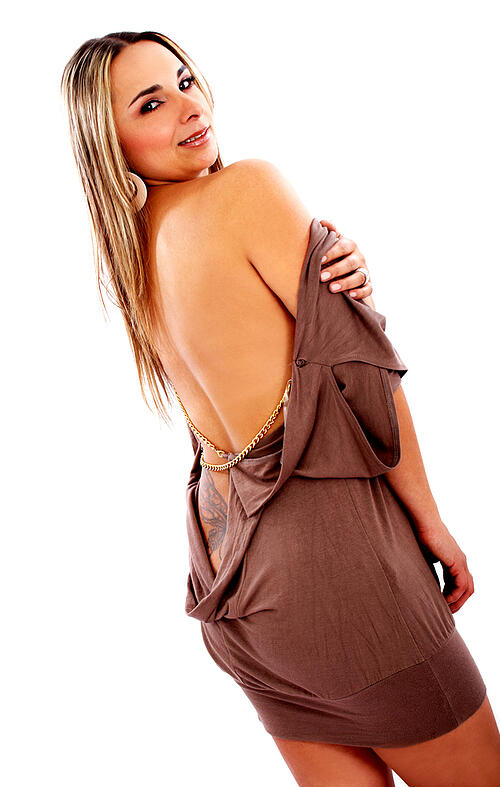 beautiful fashion girl with a brown dress where she is smiling and has a bare back and shoulders