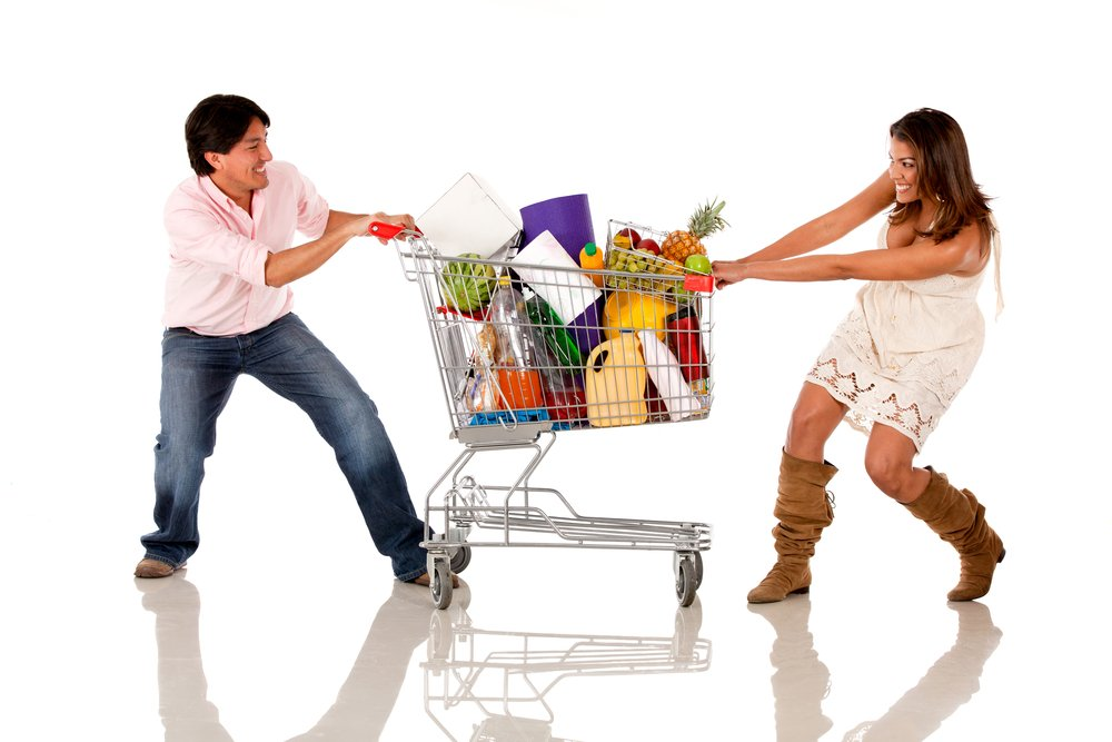 Couple fighting over a shopping cart - isolated over white