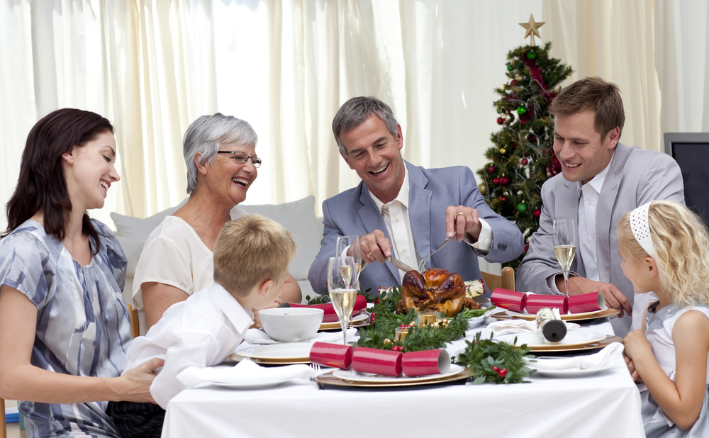 Family eating turkey in Christmas Eve at home
