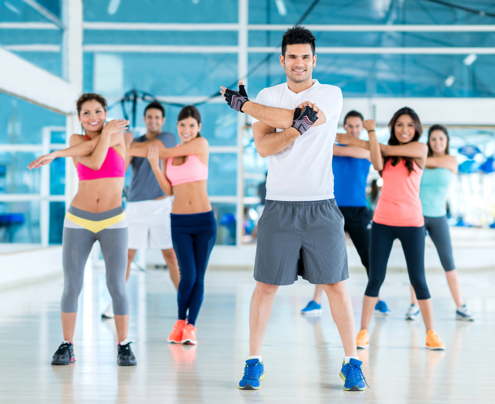 Group of people exercising at the gym looking happy