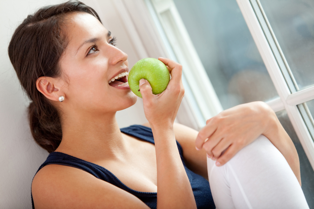 Healthy eating woman biting a green apple-1