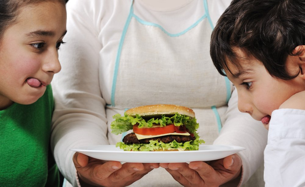 Mom prepared delicious hamburger for little boy and girl